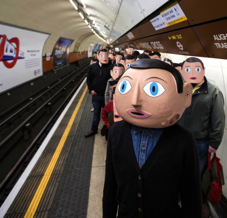Frank's signature papier-mâché head in the London tube.